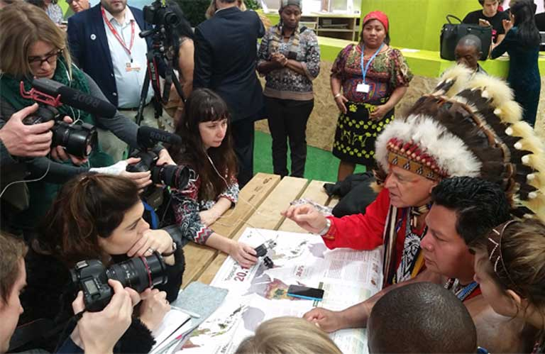 2)Indigenous leaders present research on land rights at a Green Zone press conference at Paris Climate Summit last December. Photo by Mitch Paquette
