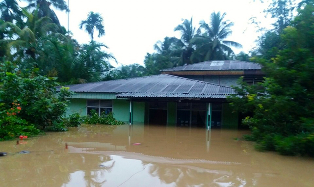 A flood in Riau province's Rokan Hulu area, on the island of Sumatra. Photo courtesy of the National Disaster Mitigation Agency