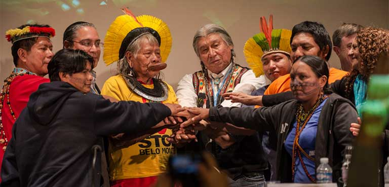 Munduruku representatives gathered with international environmental leaders in Paris during the December 2015 United Nations climate change summit (COP 21) and presented their case against the Brazilian dams. Photo by Fábio Nascimento/Greenpeace