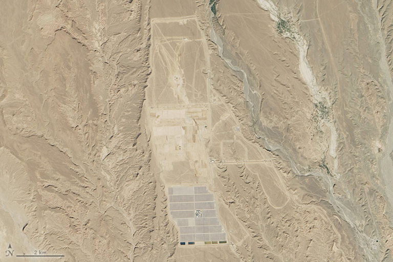 "Image from NASA observatory shows the first phase of the solar complex, Noor 1, located at the ""door of the desert"" in the south-central Moroccan town of Ouarzazate. Image by Jesse Allen, using Landsat data from the U.S. Geological Survey."