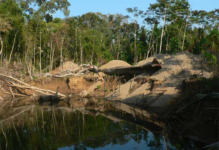 "A flooded gold mine in Madre de Dios, Peru. The study reviewed multiple human impacts on freshwater ecosystems, including dam-building, mining, land-cover change, and climate change. Individually, each of these can cause harm and alter how the ecosystem functions, but the scientists warn that they will also interact, with ""the potential to trigger cascading effects that can significantly degrade these freshwater ecosystems."" Photo © Claire Salisbury"