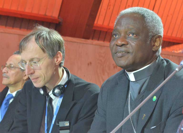 Cardinal Turkson during a presentation at COP21 in Paris. The Vatican delegation worked closely with climate negotiators, and the encyclical is said to have influenced the language in the final Paris Agreement preamble. Photo by Justin Catanoso.