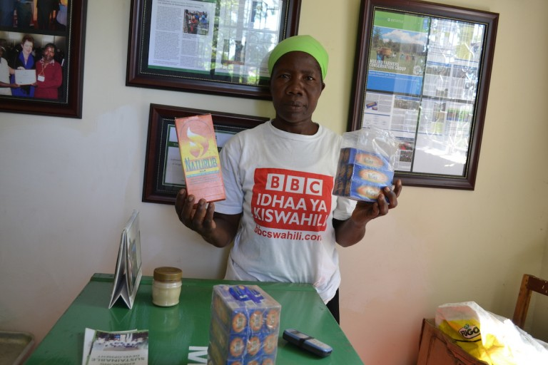 Mary Lumiti displays some of the finished products manufactured from forest herbs. Photo by Isaiah Esipisu.
