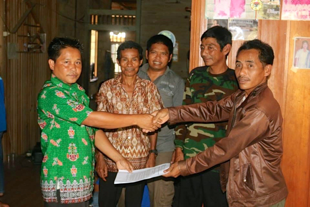 Indigenous Dayak leaders sign documents related to their customary land claims in Central Kalimantan last year. AMAN is helping indigenous groups across Indonesia map their lands. Photo courtesy of Walhi