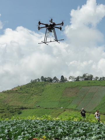 A drone that could be used to spray crops or forest plantations. The demonstration took place during a workshop on automated forest restoration this fall in Thailand. Photo by S. Elliott.