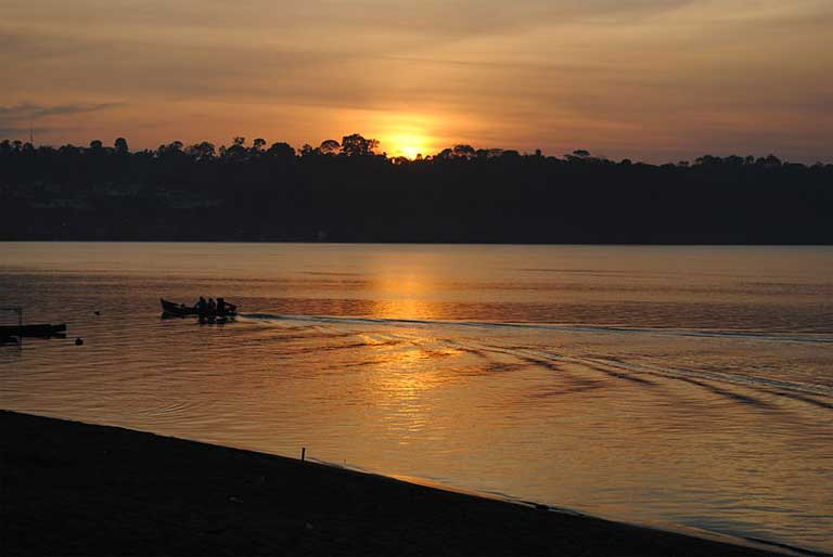 Sunset over the Xingu River. The Belo Monte dam on the Xingu, the proposed Sāo Luiz do Tapajós dam, and six more large dams proposed for the Tapajós basin do more than staunch the flow of once wild rivers, they also bring urbanization and urban problems such as street crime and poverty to once remote areas. Photo by Analita Freitas Duarte licensed under the Creative Commons Attribution-Share Alike 4.0 International license.