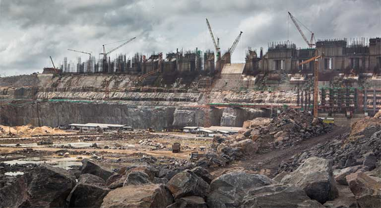 Construction site of the Belo Monte dam, on the Xingu river, Brazil. There have been important failings in the licensing process here, say government critics, including a deeply flawed Environmental Impact Assessment, and a lack of free, prior and informed consent for affected communities. Photo © Carol Quintanilha / Greenpeace