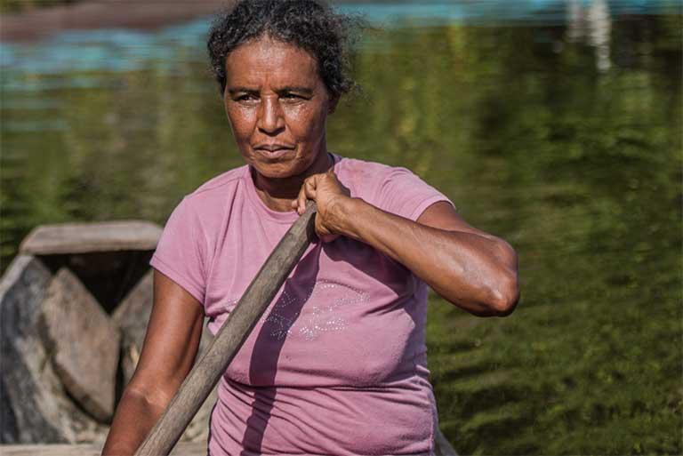 Dona Zefa in her canoe. Photo by Mauricio Torres
