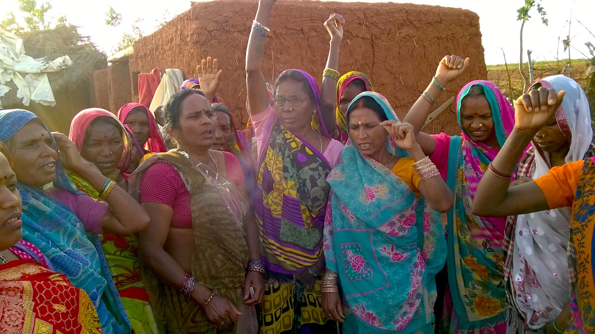 In April 2015, indigenous Adivasi and Dalit women in Uttar Pradesh, India, protested an ordinance doing away with a requirement that local village assemblies consent to any land acquisitions in their jurisdictions before they can proceed. Photo by Arpitha Kodiveri.
