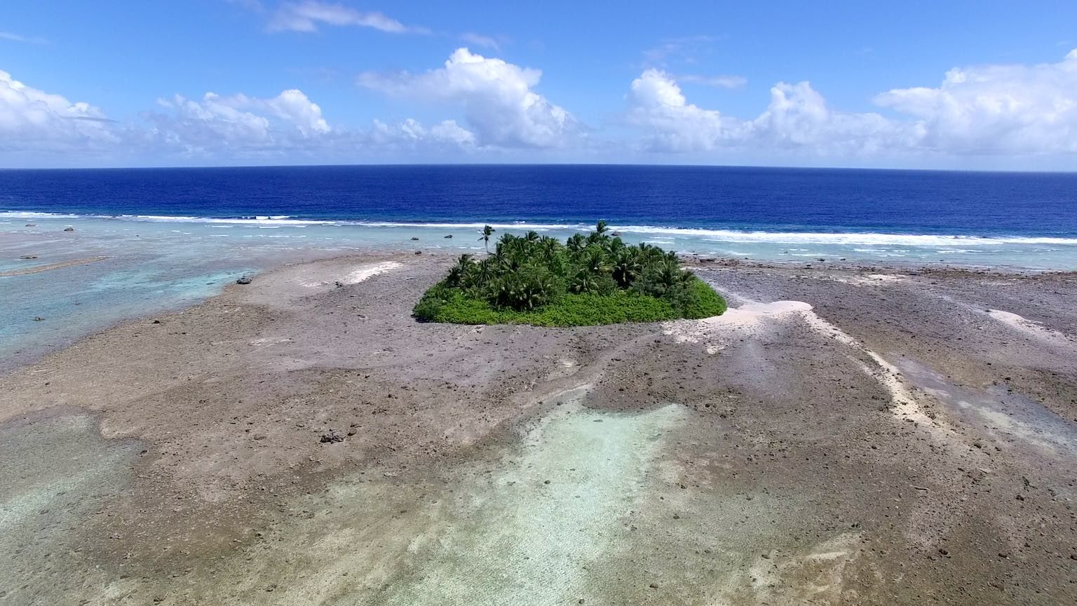Aerial photo of Mili Atoll (172E, 6N), Republic of the Marshall Islands taken by a drone during our recent fieldwork in the western tropical Pacific. Photo by Jeffrey P. Donnelly.