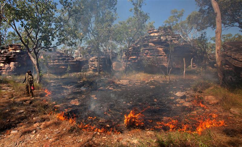 Ray Nadjamerrek demonstrates traditional burning. Photo courtesy of United Nations University.