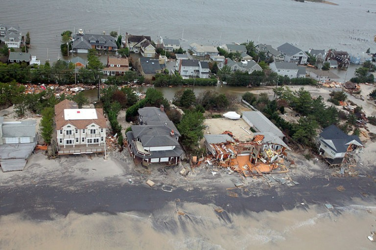 Climate change helped to intensify Hurricane Sandy's impacts, which included disease-causing mold in water damaged homes, and the overwhelming of waste treatment infrastructure which released large amounts of potentially disease-causing raw sewage into streets and homes. Photo courtesy of the US National Guard.