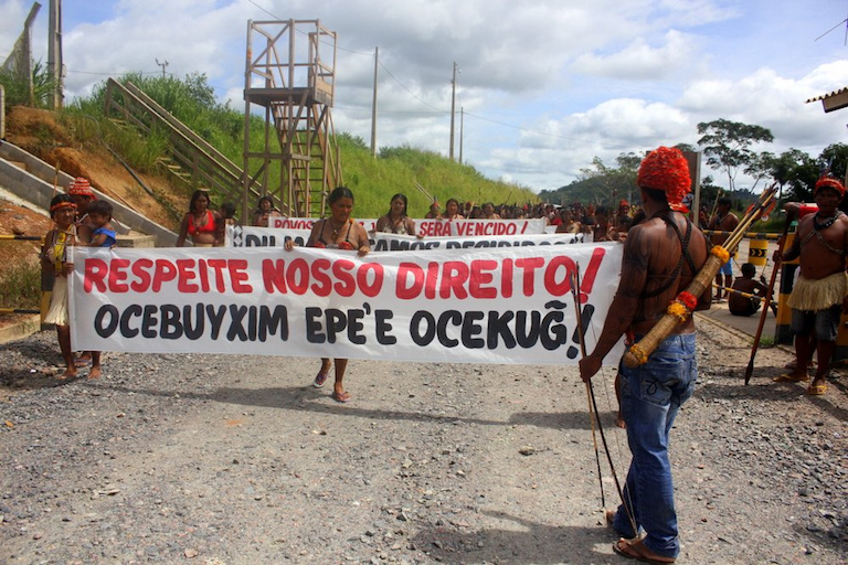 """Respect Our Rights,"" reads a banner at an indigenous protest against the fiercely contested Belo Monte hydro-electric dam under construction in northern Brazil. Photo by Ocupacao Munduruku."