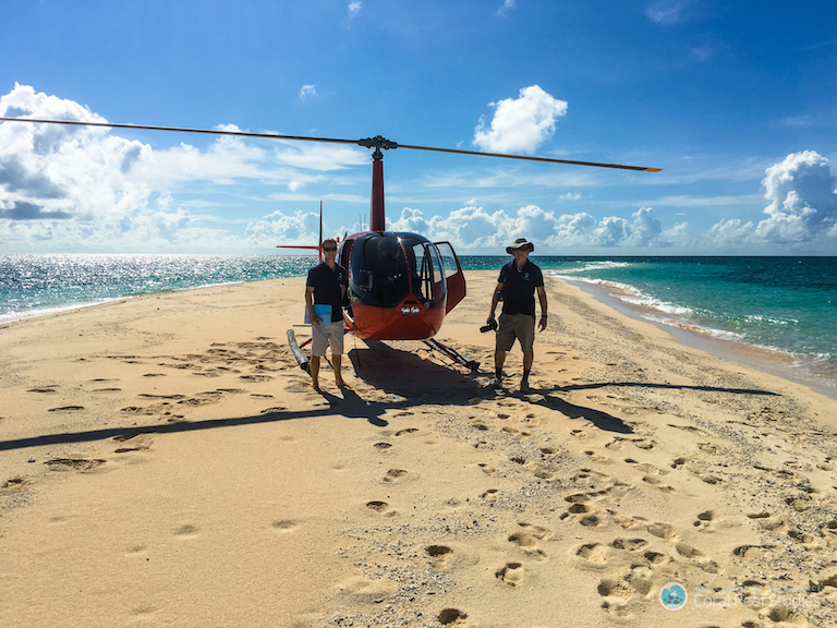 A survey team prepares to fly over the Great Barrier Reef to document coral bleaching. Photo by ARC Centre of Excellence for Coral Reef Studies / Terry Hughes.
