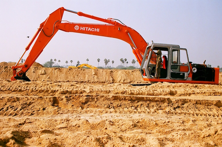 An earth mover prepares to load sand in Kanchipuram, Tamil Nadu. Photo by Sibi Arasu.