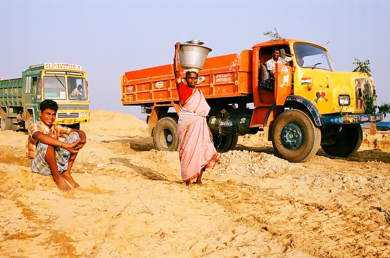 A local woman sells food to truck drivers waiting in line to collect a load of sand, in Kanchipuram, Tamil Nadu. Photo by Sibi Arasu.