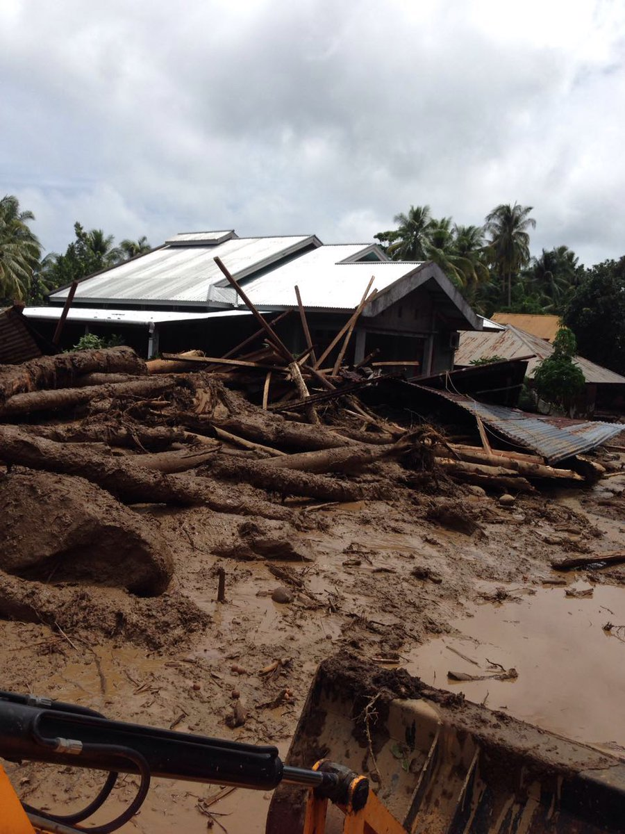 A house crushed by a landslide this month in Sangihe, where 241 buildings and infrastructures were damaged and 2,022 people displaced, according to the government. Photo courtesy of @Sutopo_BNPB