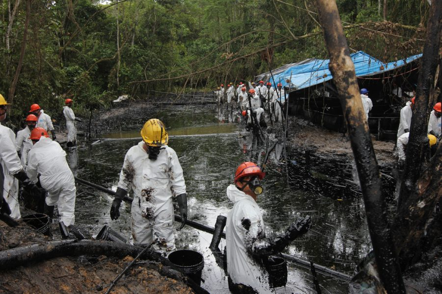 Workers scoop oil out a stream near Chiriaco, in northern Peru, where crude spilled from a pipeline in late January. Photo by Barbara Fraser.