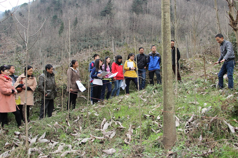 An expert invited by Longxi Hongkou National Nature Reserve in Sichuan Province teach locals how to patrol the forest and set up cameras to monitor the protected region, on March 14, 2015. Photo courtesy of Dujiangyan Nature Protection Association.