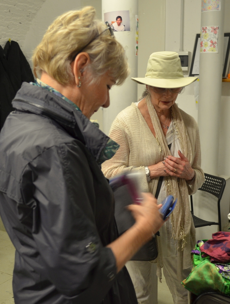 Long time friends Gail Griffith and Emmylou Harris checking out jewelry made by refugees. Photo by Justin Catanoso