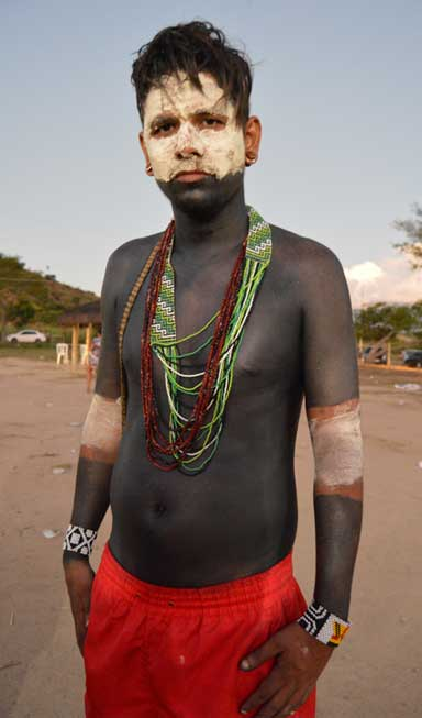 Geovany Krenak, caçique, or chief, of the Krenak indigenous group, wears traditional body paint on a day of celebration. Photo by Zoe Sullivan