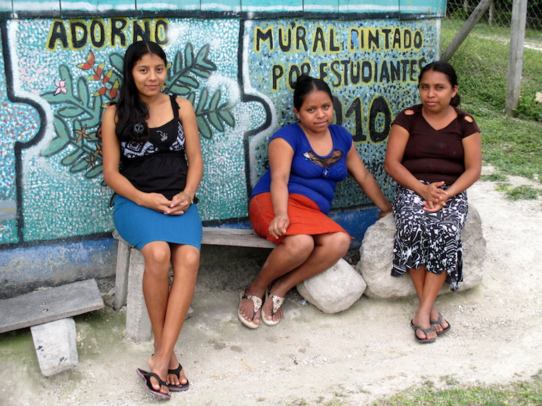 Uaxactún village residents chat outside the xate warehouse in their community forest concession, located in the multi-use zone of the Maya Biosphere Reserve. Photo by Sandra Cuffe.