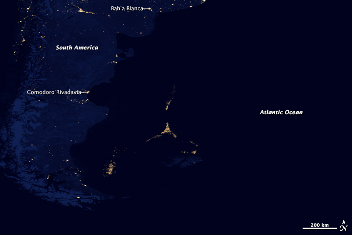 Fishing boats adorned with lights for night fishing are picked up by the Suomi-NPP satellite. This is the second-largest squid fishery on the planet. Image courtesy of NASA Earth Observatory/NOAA National Geophysical Data Center