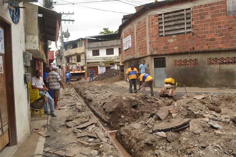 Public Works in Asa Branca: Workers install sewer and water pipes in the Asa Branca favela of Rio de Janeiro. Such work is often long delayed by lack of money or bureaucratic red tape. Photo by Catalytic Communities
