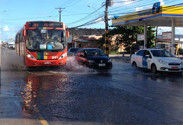 "Afogados bus: A bus navigates an enormous puddle in the Afogados neighborhood of Recife. ""Afogados"" ironically means ""drowned,"" perhaps an apt description for a city built on a mangrove swamp with inadequate water and sanitation systems. Photo by Zoe Sullivan"