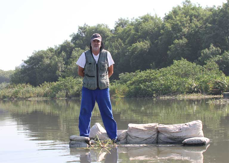 Barra da Tijuca Lagoon and biologist Mário Moscatelli. Photo courtesy of Mário Moscatelli.