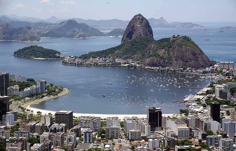 Though beautiful from above, Guanabara Bay is a dumping ground for raw sewage, hospital waste, trash, and a breeding ground of viruses, bacteria and fecal coliforms. Photo by Halley Pacheco de Oliveira licensed under the Creative Commons Attribution-Share Alike 3.0 Unported license