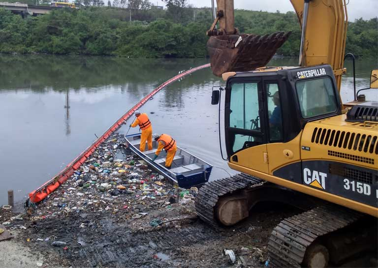 Workers collect trash from a Rio river to keep it out of Guanabara Bay where Olympics aquatic events will occur. Photo by Rio de Janeiro Environmental State Secretariat