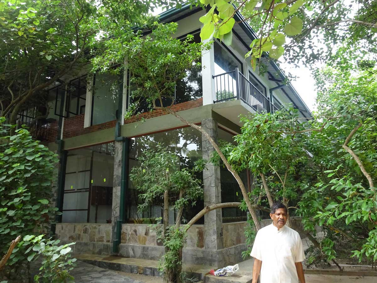 Sudeesa Chairman Anuradha Wickramasinghe stands outside the Seacology-Sudeesa Mangrove Museum. Photo courtesy of Seacology