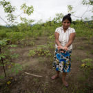 Levita holds a layer of dried crude oil from her farmland along the Marañon River. Photo by Brett Monroe Garner.