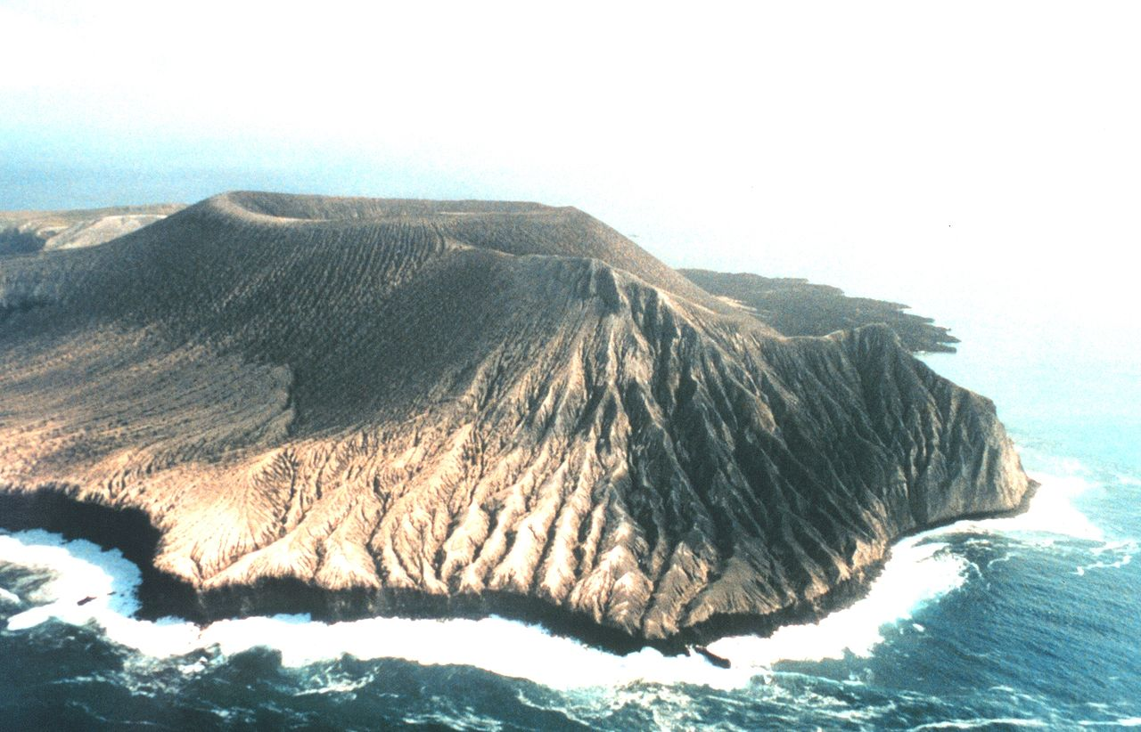 Montículo Cinerítico (front) and Bárcena (behind), volcanic cones on San Benedicto, one of the Revillagigedo Islands. Bárcena has existed only since 1952. Photo: Public Domain.