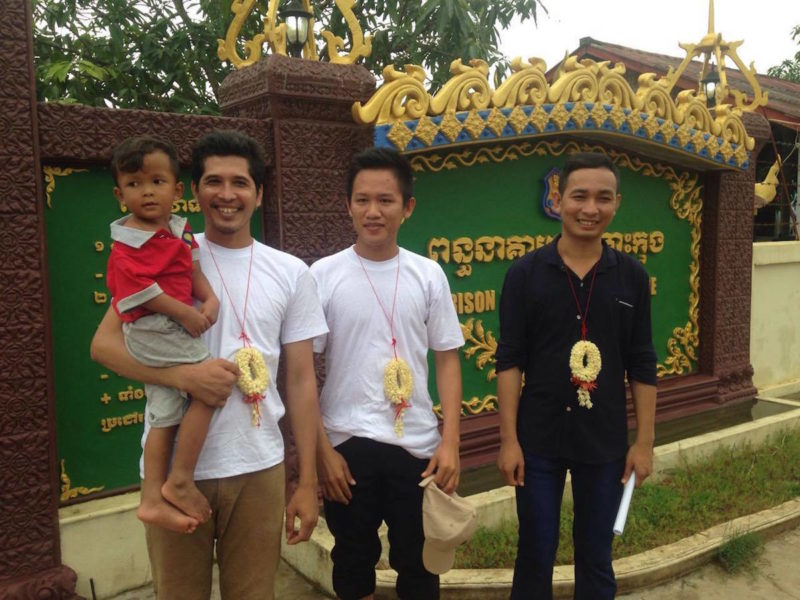 Sim Somnang reunited with his son (left), Try Sovikea (center), and San Mala (right) stand outside Koh Kong prison, having just been released. Photo by Mot Kimry/Mother Nature Cambodia.