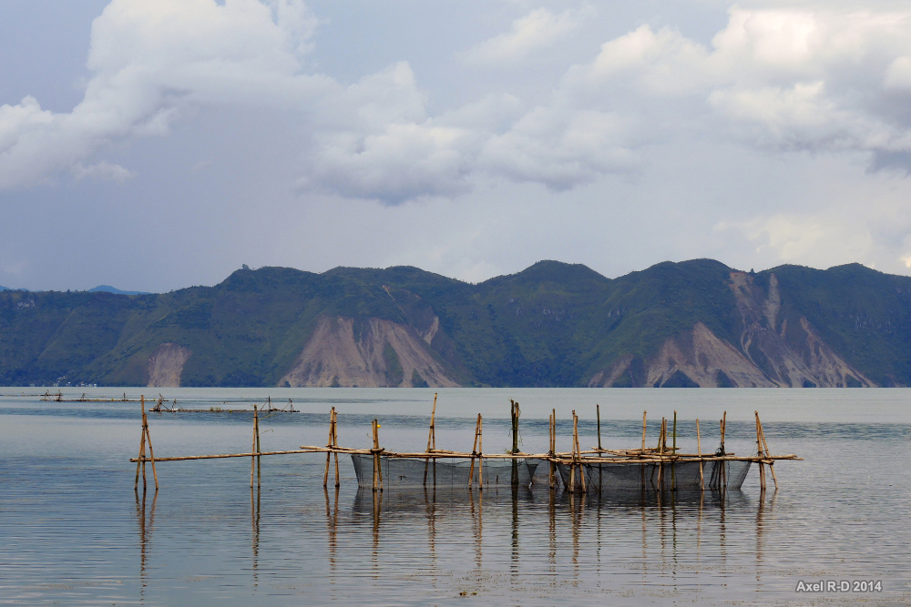 A fish farm in Lake Toba, the world's biggest volcanic lake. Photo by Axel Drainville/Flickr