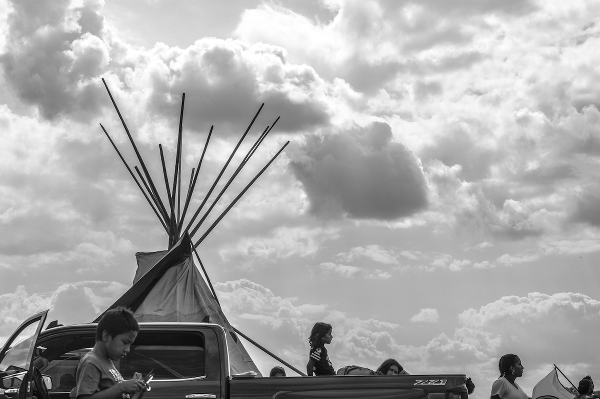 Children listen to speakers at the camp on August 20, 2016. Photo by Rob Wilson for Bold Alliance
