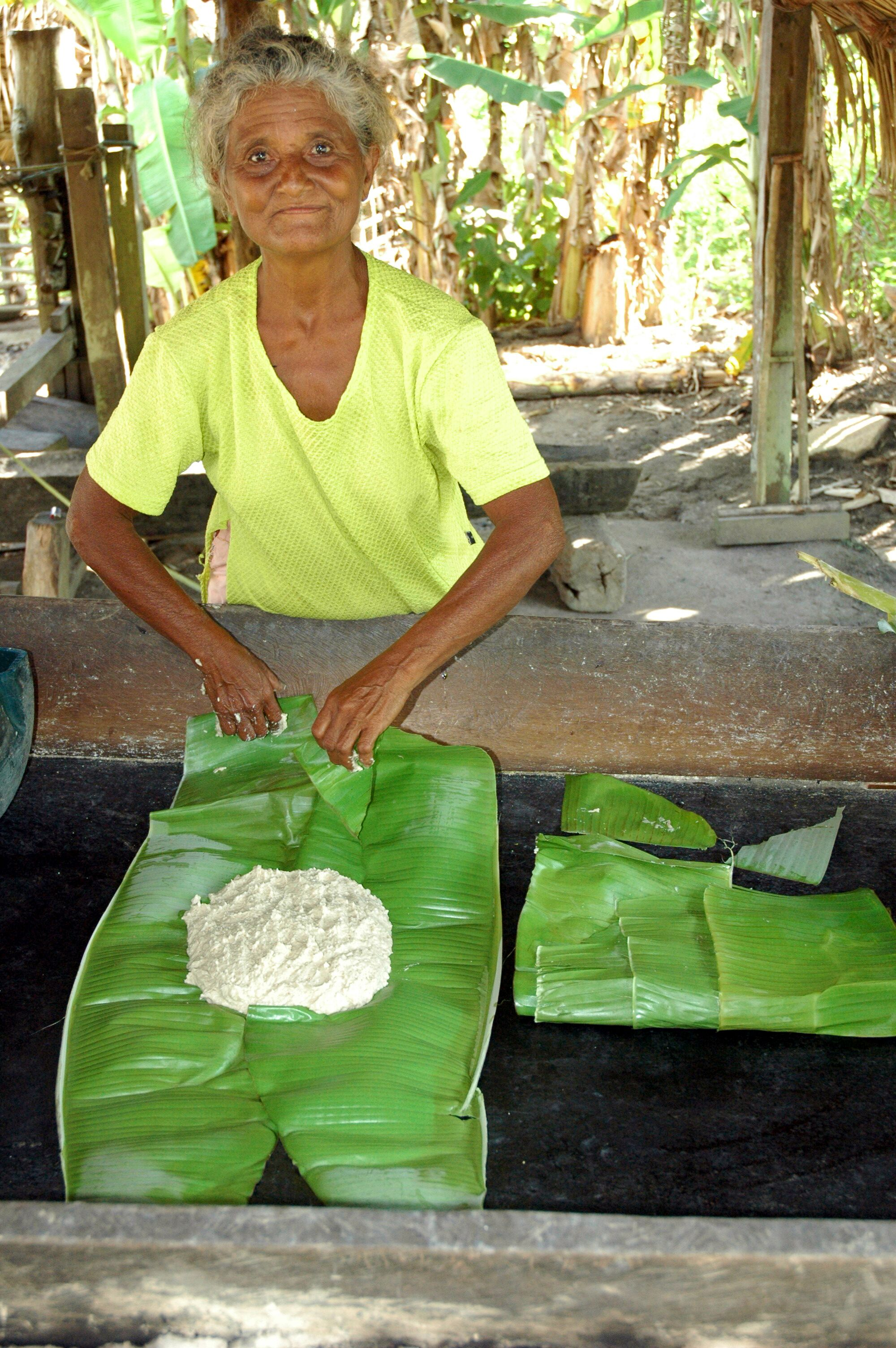 Dona Lausminda de Jesus, from the Tapajós river community of Montanha e Mangabal, making a cake. Traditional river settlements and indigenous villages throughout the Tapajós would be impacted by the waterway and dams, and by the subsequent deforestation brought by logging, mining, and agribusiness. Photo by Mauricio Torres