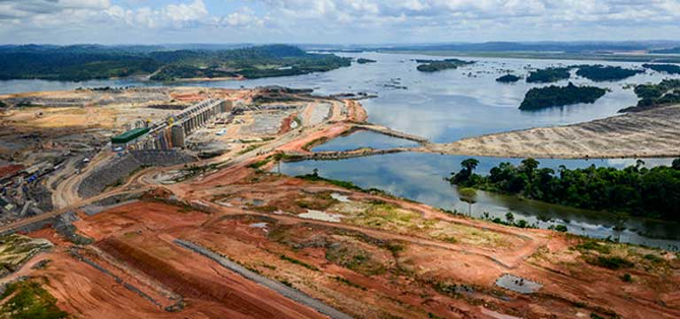 The Belo Monte dam under construction, showing forest clearance at the dam site. The major dams planned for the Tapajós basin would cause considerable deforestation and displace river communities. Photo courtesy of Secretaria-Geral da Presidencia da Republica