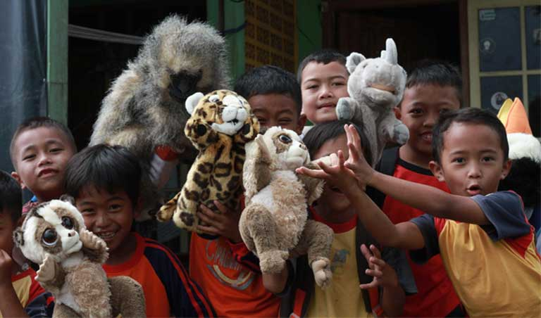 Children in the Little Fireface Project's Nature Club ('Klub Alam') play with wildlife puppets. Conservation education is key to conserving lorises. Photo by Daniel Geerah