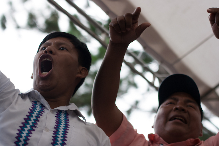 Ricardo Miranda (left), a member of the M10 movement representing Ngäbe communities affected by the Barro Blanco dam, and Toribio Garcia, president of the Ngäbe Regional Congress, protest the agreement. Photo by Camilo Mejia Giraldo