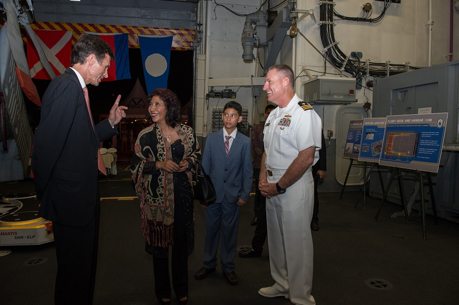 Indonesian fisheries minister Susi Pudjiastuti, center, speaks with Robert Blake, the U.S. ambassador to Indonesia, left, during a reception on board a U.S. combat ship while in port in Jakarta. Photo courtesy U.S. Pacific Fleet
