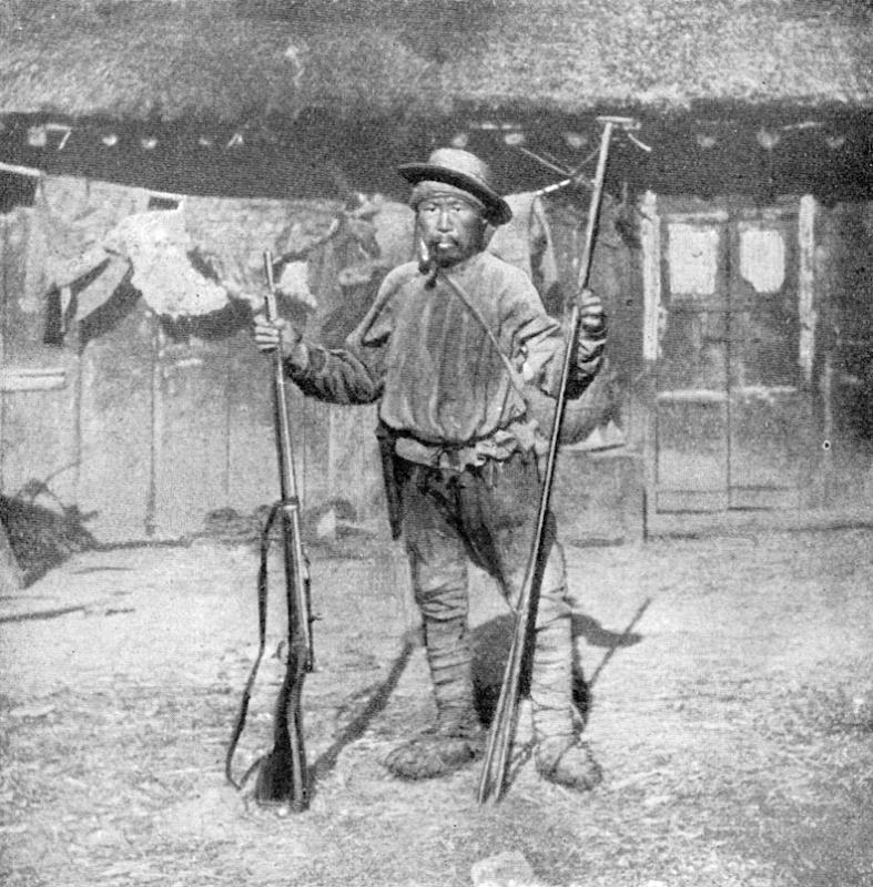 Dersu Uzala posing with a rifle. Image courtesy of Indiana University Press