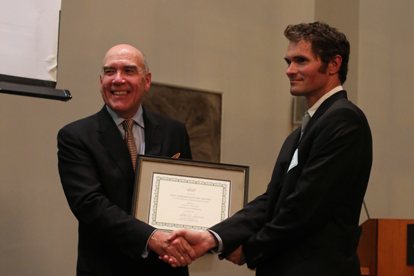 Field Museum President and CEO Dr. Richard Lariviere presenting the Parker/Gentry Award to Rhett Butler during a ceremony on September 3, 2014.