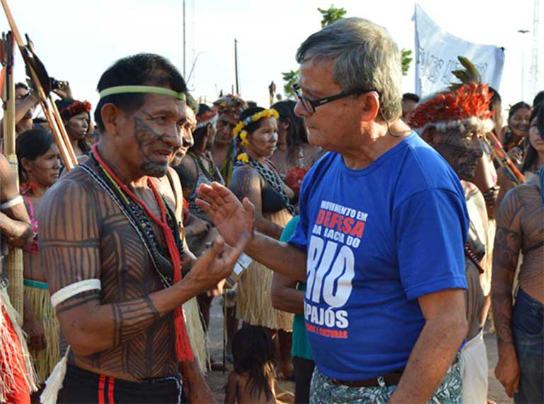 Father Sena talks with one of the Munduruku indigenous leaders who traveled to Itaituba for the summit. The Munduruku are vehemently opposed to dam plans for the Tapajós and were instrumental in defeating the proposal for the São Luíz de Tapajós mega-dam. Photo by Zoe Sullivan