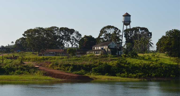 A water tower looms over Fordlandia on the banks of the Tapajós River. Fordlandia was an industrial community built by the Ford Motor Company in the early 20th century to harvest rubber. It failed. Many Amazon activists worry that other outside plans, including government and agribusiness proposals for more than 40 dams in the Tapajós region, would also lead to failure. Photo by Zoe Sullivan