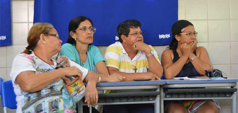 Joelma Viana, Executive Producer of the Amazon News Network (far right) listens to discussions during a communications tools and strategy workshop during the 3-day environmental and social summit in Itaituba. Photo by Zoe Sullivan