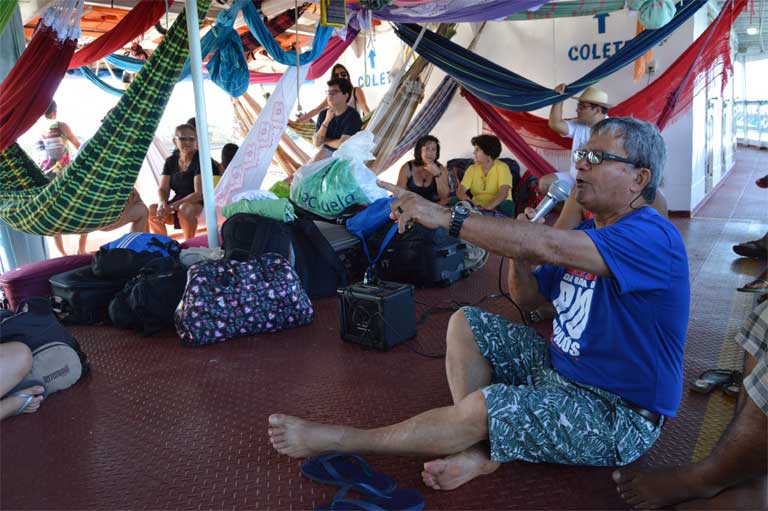 Father Edilberto Sena moderates an open mic session on one of the three boats that traveled overnight from Santarém to Itaituba for a three-day environmental and social summit at the end of August. Photo by Zoe Sullivan