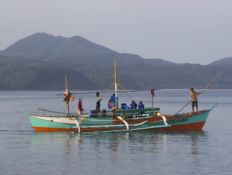 A local Babuyan Island outrigger fishing boat that Jo Marie Acebes refitted as a research vessel, North Philippines. Photo by Melati Kaye